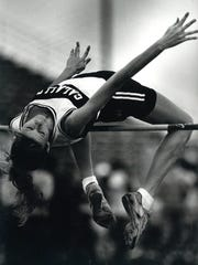 Calallen's Amy Acuff clears the bar enroute to winning the women's varsity high jump and seeting a new meet record with a leap of 5-feet, 8-inches on March 24, 1990.