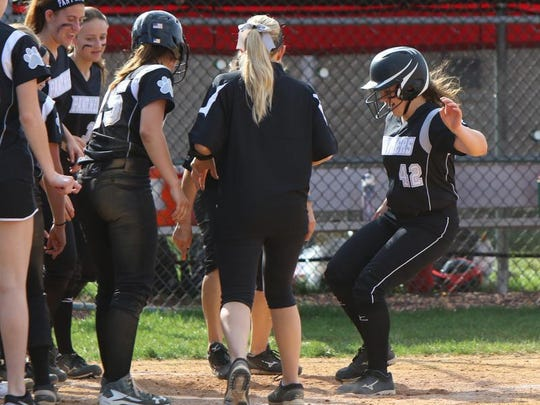 B-R shortstop Sam Ward touches the plate after her second-inning homer