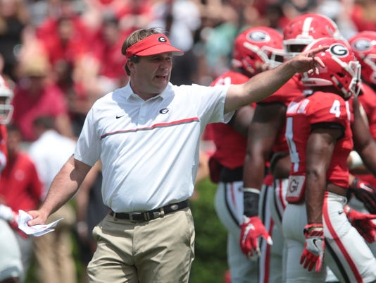 Georgia coach Kirby Smart calls plays from the field during the NCAA college football team's G Day at Sanford Stadium in Athens, Ga., Saturday, April 22, 2017. (John Roark/Athens Banner-Herald via AP)