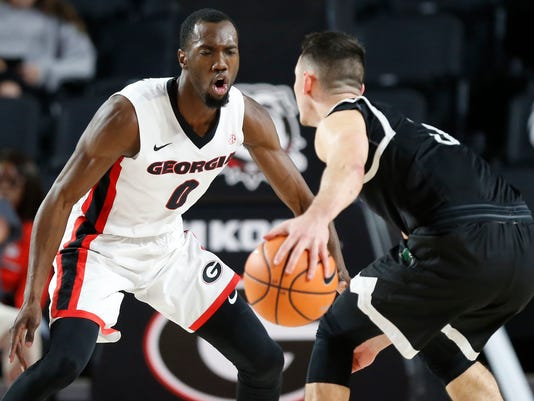 Georgia guard William Jackson (0) defends against South Carolina Upstate guard Jure Span (3) in the first half of an NCAA college basketball game in Athens, Ga., Tuesday, Nov. 14, 2017. (Joshua L. Jones/Athens Banner-Herald via AP)