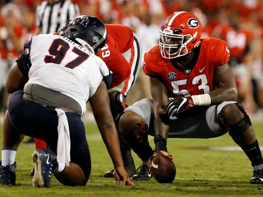 FILE - In this Sept. 16, 2017, file photo, Georgia center Lamont Gaillard (53) gets ready to run a play in the second half NCAA college football game against Samford in Athens, Ga. Gaillard is a 301-pound fourth-year junior who gives Georgia a chance to move Alabama nose guard Da'Ron Payne one-on-one, but he will probably need some help. (Joshua L. Jones/Athens Banner-Herald via AP, File)