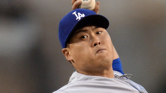 Dodgers starting pitcher Hyun-Jin Ryu throws in the first inning of the game against the Angels at Angel Stadium of Anaheim.