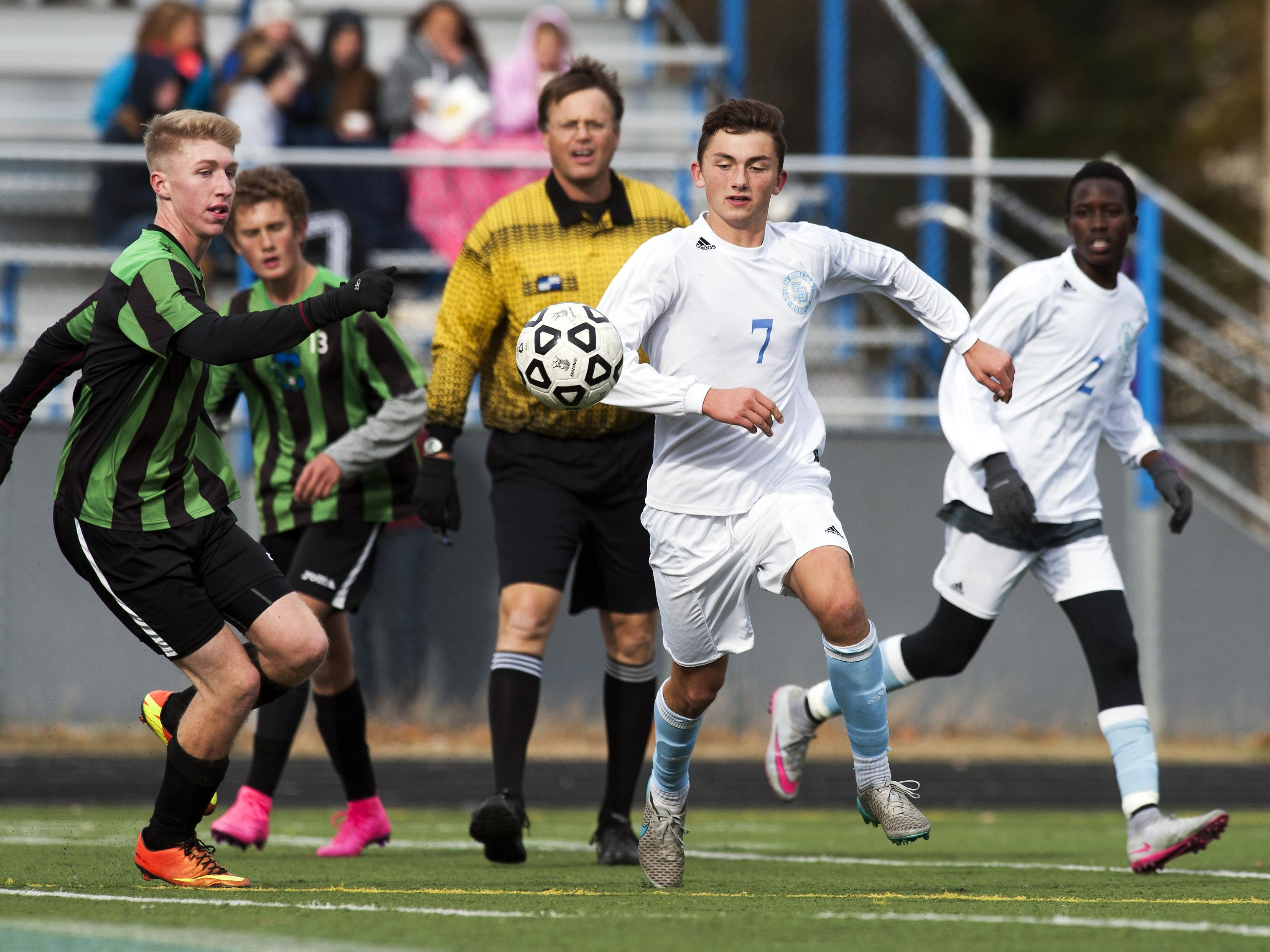 South Burlington's Ben Lambert (7) and Colchester's Amdrew Lynch (9) chase down the ball during a Division I high school boys soccer quarterfinal game at South Burlington on Saturday. The Rebels won 1-0 to advance to Tuesday's semifinals.