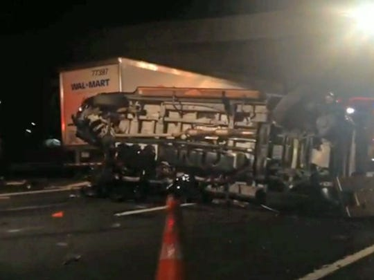 In this image from video the limousine bus carrying Tracy Morgan and six other people lies on it's side early Saturday morning  on the New Jersey Turnpike. A New Jersey highway crash that severely injured Tracy Morgan and killed another comedian is drawing attention to the dangers of tired truckers just as the industry and its allies in Congress are poised to roll back safety rules on driversâ?? work schedules.