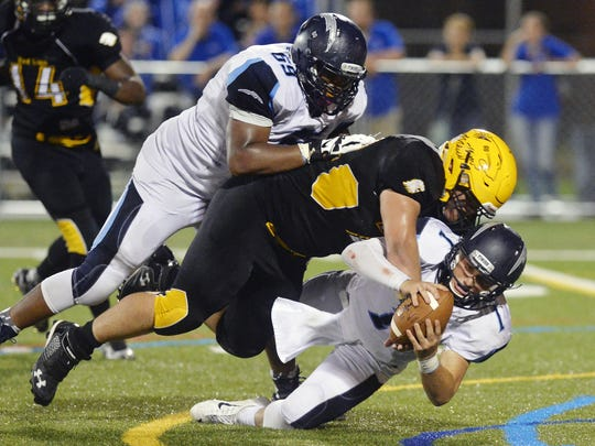 Red Lion's Nick Argento sacks Manheim Township quarterback Erik Benjamin in the fourth quarter of a high school football game Friday, Sept. 11, 2015, at Red Lion.