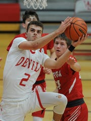West Side senior Charlie Nycz drives to the basket Tuesday night against Attica.