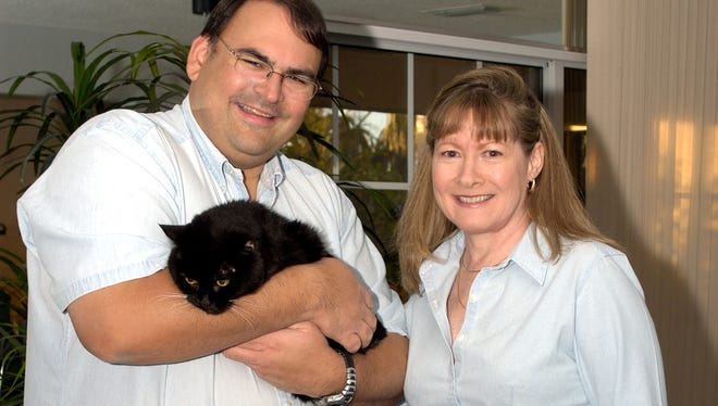 Raj S. Shah and Joanne Regan are pictured with their cat, Iggi, in 2005. Shah, a software engineer, died in 2007 after an 18-year battle with leukemia.