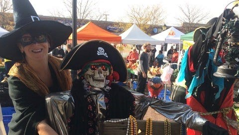 Chamber of Commerce Director Mary Martin and friends guard their treasures at the haunted market.