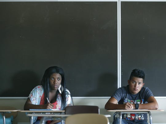 Labria Buie and Giezi Gonzalez attend a global science class during the Rochester City School District summer school program at Edison Technology Campus on July 23, 2015.
