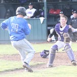 Blanchet's Jack Coen (29) starts to slide as Jefferson catcher Justus Arlandson looks for the throw in Blanchet's 11-0 win on Friday, April 29, 2016.