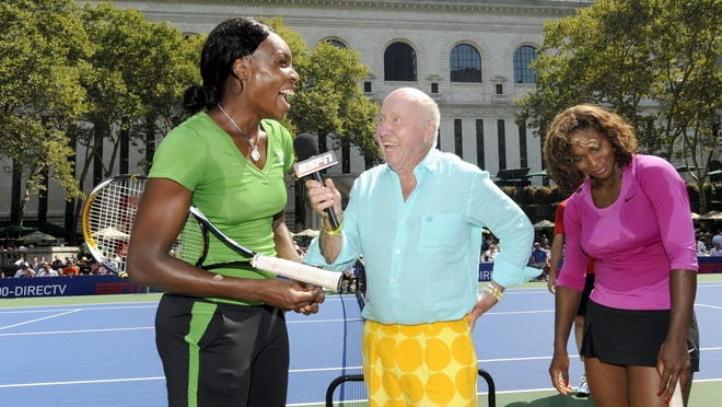 Long-time tennis commentator Bud Collins was as known for his colorful outfits as he was his cheerful personality. Here, he interviews Venus and Serena Williams at the U.S. Open in 2009.