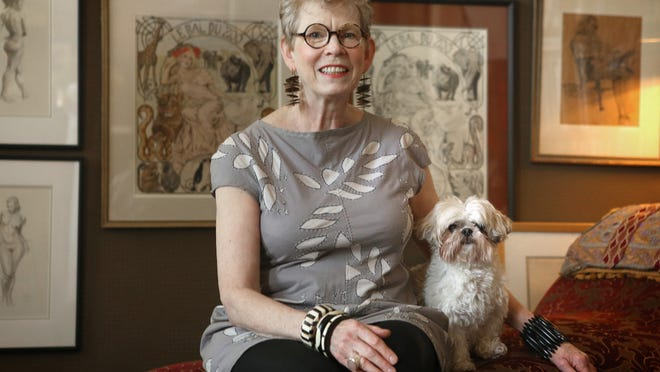 Stylemaker Claudia Hammer with her dog Whirly Girl at her studio in Louisville. May 13, 2014.