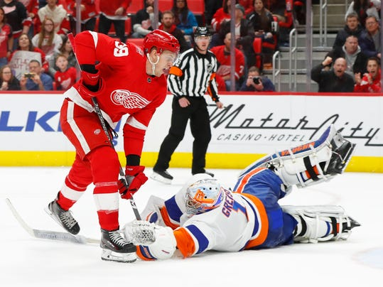 New York Islanders goaltender Thomas Greiss (1) stops a Detroit Red Wings right wing Anthony Mantha (39) breakaway during overtime in an NHL hockey game Saturday, April 7, 2018, in Detroit. The Islanders won 4-3. (AP Photo/Paul Sancya)
