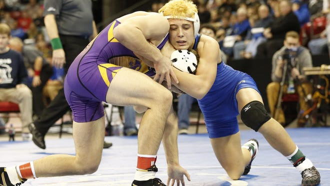 Josh Verbeten of Wrightstown (right) wrestles Josh Becker of Sheboygan Falls in a Division 2 semifinal Friday.