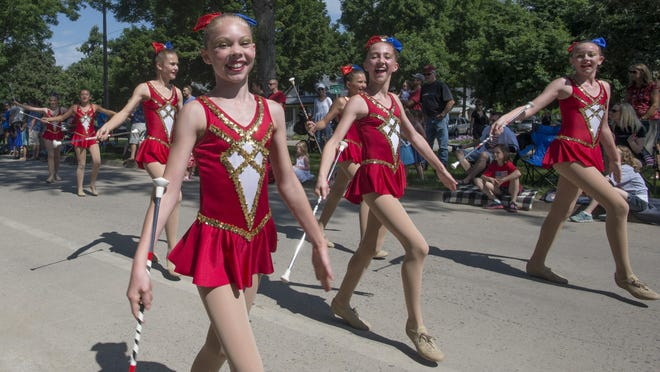 The Golden Girls Baton Academy performs in the Fourth of July parade on West Mountain Ave. Saturday, July 4, 2015. The parade featured the 101st Army Band, the Poudre Fire Authority and classic cars.