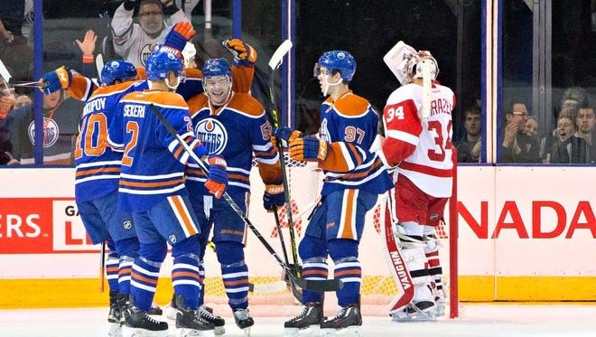 The Oilers gather after Mark Letestu's goal on Petr Mrazek in the first period.
