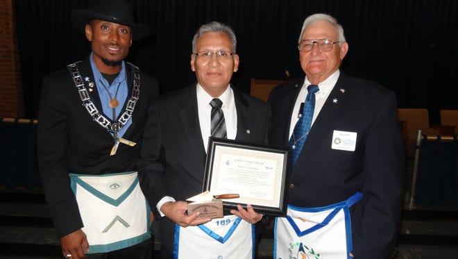 Worshipful Master John Hollowell (from left), Past Master Ralph Escarzaga, and District Deputy Grand Master Billy Paul.