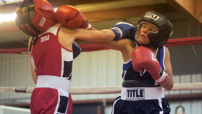 Superior Boxing's Joseph Mesa, right, trades right hands with Landon Smith of The Works New Mexico Team during Saturday's amateur fight card at the first-ever Henry Gutierrez Memorial Tournament held at the Southwestern New Mexico State fairgrounds in Deming.
