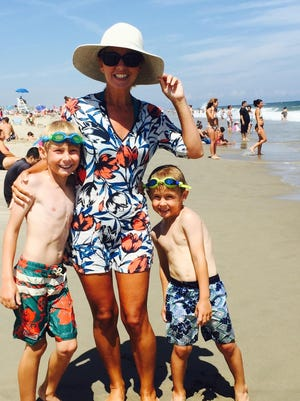 Tracy Lantz with J. Crew Factory Tunic top, Gap hat, Kate Spade shades and Reef flip flops. She is shown with Cooper, 8, and Sawyer, 5.