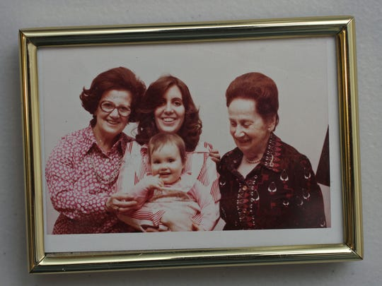 "A four-generation photo of Evelyn Rauch, center, holding her daughter. Her mother is at left and grandmother at right. Rauch is the author of ""Surviving Steffi,"" a book about her mother's suicide and hidden past and experience with the Holocaust."