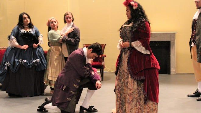 "From left: Marcellina (Krystina Arguello), Barbarina (Cartrina Lasyone), Alyssa Anderson (Cherubino), Count  Almaviva (Aaron Dominguez, kneeling), Countess Almaviva (Serayah Peters) and Bartolo (Chasen Watson) in a rehearsal scene from ""The Marraige of Figaro."""