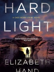 "This book cover image released by Minotaur shows, ""Hard Light,"" by Elizabeth Hand. (Minotaur via AP)"