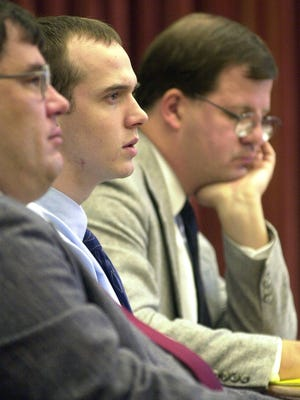 Richard Burkhart, center, and his lawyers Carl Jensen, right, and Vince Van der Hagen, left, listen to testimony from his co-defendant Michael John Staley on Sept. 11, 2002, in District Court.