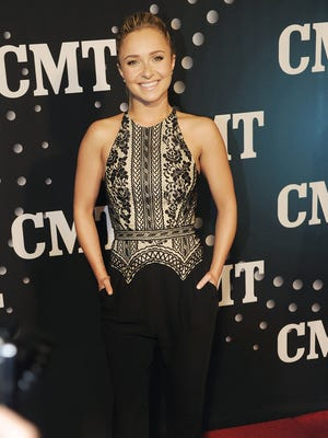 "Hayden Panettiere, star of ABC's ""Nashville,"" is on the Red Carpet for the the fourth annual CMT Artists of the Year ceremony held at the Music City Center in downtown Nashville Dec. 3, 2013."