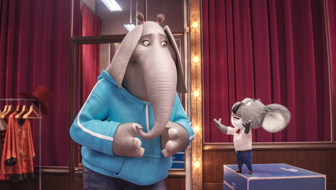 Buster (voiced by Matthew McConaughey, right) tries to instill confidence in shy Meena (Tori Kelly) in 'Sing.'