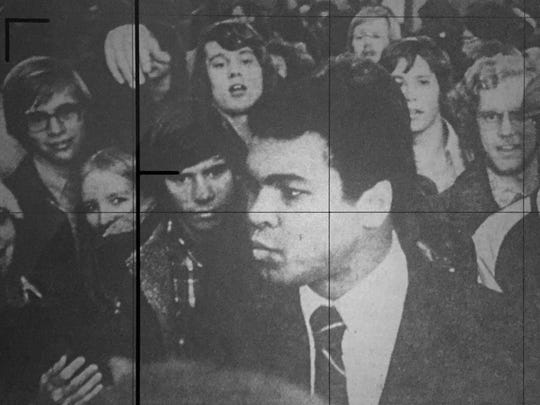Muhammad Ali is surrounded by admirers following his