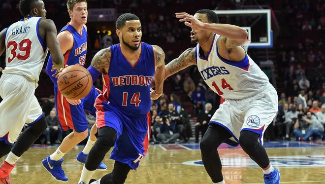 Detroit Pistons guard D.J. Augustin (14) drives to the net as Philadelphia 76ers guard K.J. McDaniels (14) defends during the second quarter of the game at the Wells Fargo Center.