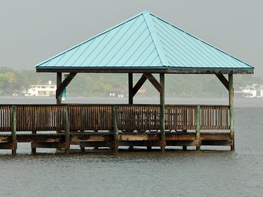 The fishing pier at Suntree Rotary park, south of Rockledge shows the high water level of the Indian River lagoon as of Sunday, October 11.