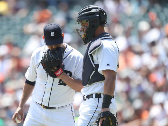 James McCann, right, talks with Anibal Sanchez in the