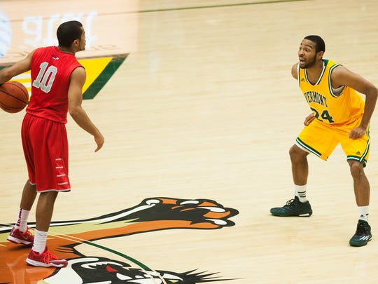 Catamounts guard Dre Wills, right, shut down Stony Brook's Carson Puriefoy in the team's Jan. 10 matchup at Patrick Gym.