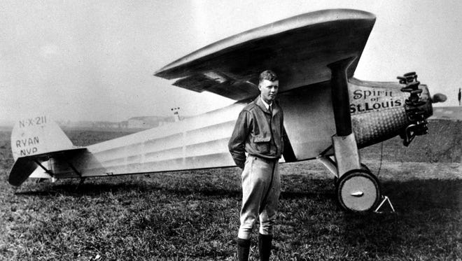 """Charles A. Lindbergh poses with his plane """"The Spirit of St. Louis"""" in this 1927 file photo."""