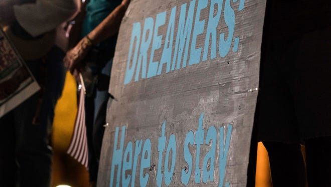 """Valley faith leaders host a vigil for """"dreamers"""" and their supporters at U.S. Immigration and Customs Enforcement headquarters in Phoenix on Sept. 4, 2017."""
