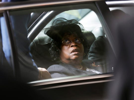 Judy Scott arrives for the funeral of her son, Walter