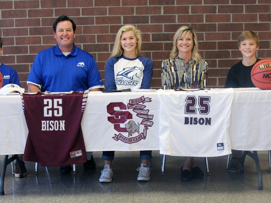 Station Camp High senior Emiline Payne recently signed her letter of intent to continue her education and basketball career at the University of Alabama at Huntsville. Pictured are Emiline's brother, Chris Payne, Jr.; father, Chris Payne, Sr.; Emiline Payne; Emiline's mother, Rachel Payne; and Emiline's brother, Luke Payne.