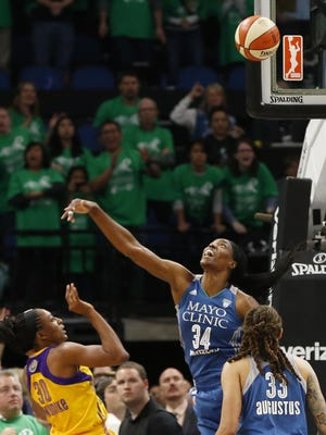 The Los Angeles Sparks' Nneka Ogwumike, left, shoots the game-winning shot over Minnesota Lynx defender Sylvia Fowles on Thursday in Game 5 of the WNBA Finals in Minneapolis.
