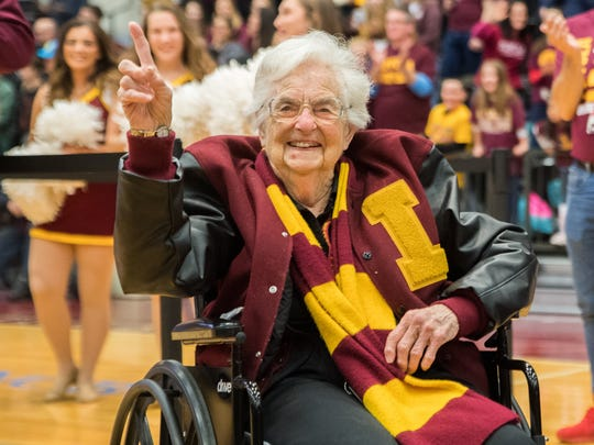 Loyola-Chicago team chaplain Sister Jean celebrates with the team at the Gentile Arena.