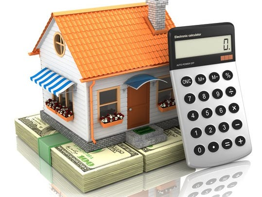 house-money-and-calculator_gettyimages-521263925_large.jpg