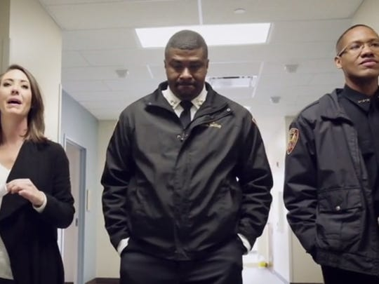 Hazlehurst Police Chief Byron Swilley (center) walks with coworkers in a video released by the Mississippi Association of Chiefs of Police.