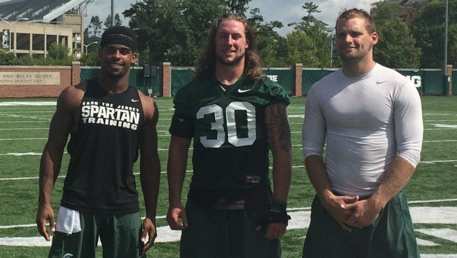 From left, Michigan State football captains Demetrious Cox, Riley Bullough and Tyler O'Connor.
