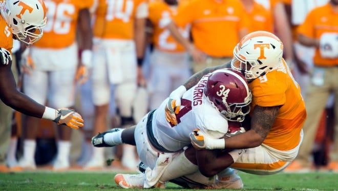 Tennessee defensive end Derek Barnett (9) tackles Alabama running back Damien Harris (34) at Neyland Stadium on Saturday, October 15, 2016 in Knoxville, Tenn.