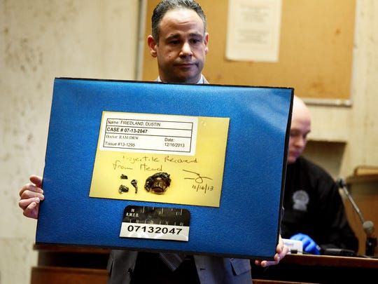 Assistant Essex County Prosecutor Ralph Amirata shows photos of the bullet fragments removed during the autopsy of murder victim Dustin Friedland.