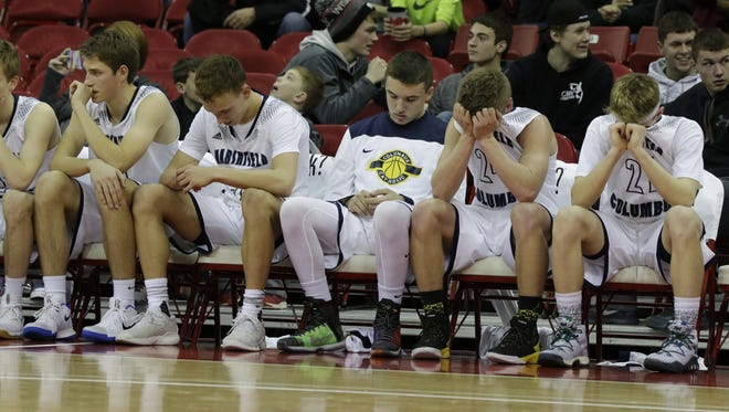 Columbus Catholic High SchoolÕs players react to the closing minute of the game against Barneveld.  Columbus Catholic played Barneveld in the WIAA State Boys Basketball Division 5 semifinal game at the Kohl Center in Madison, March 17, 2017.  Columbus Catholic lost to Barneveld 52 - 72.  Joe Sienkiewicz / USA TODAY NETWORK-Wisconsin