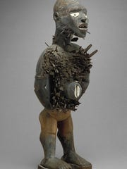 """""""Power Figure,"""" by unknown artist, 19th century, Kongo culture, Angola, at the Detroit Institute of Arts. Wood with nails, blades, cowrie shell and natural fiber."""