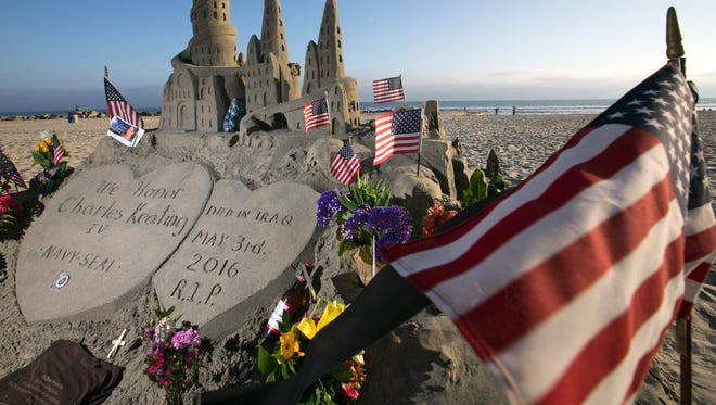 A sandcastle honoring Navy Seal Charlie Keating at the beach in front of the Hotel del Coronado in Coronado Island, Calif., on Thursday, May 12, 2016. Keating, a Navy Seal and graduate of Arcadia High School in Phoenix  died in Northern Iraq after ISIS penetrated the area on May 3, 2016. Keating's, grandfather of the same name was the famous savings and loan financier. Keating's funeral is on May 13 in Coronado Island and San Diego.