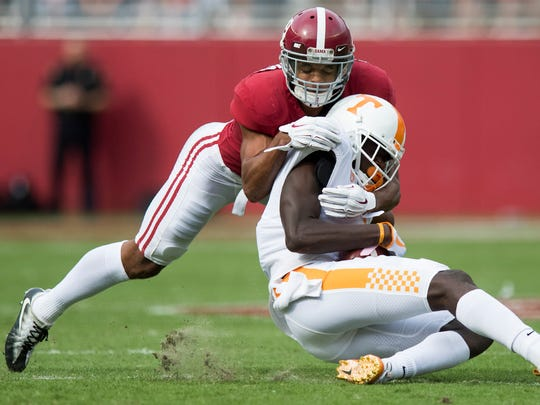 Alabama defensive back Minkah Fitzpatrick (29) stops Tennessee wide receiver Brandon Johnson (7) in first half action at Bryant-Denny Stadium in Tuscaloosa, Ala. on Saturday October 21, 2017. (Mickey Welsh / Montgomery Advertiser)