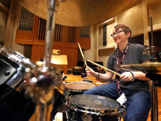Teens learn the basics of being a rock star at YEAH rock camps.